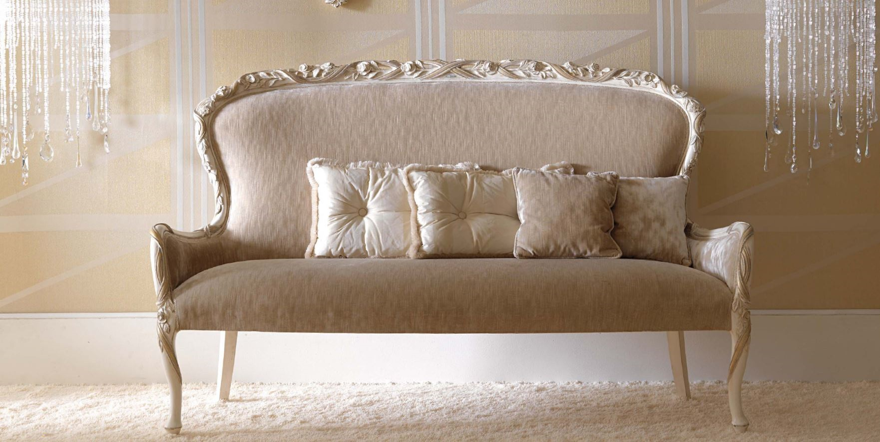 Two Seater Sofa On Carved Legs In The Soft Upholstery