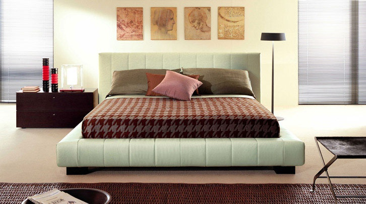 Bed from Nicole Besana with high headboard
