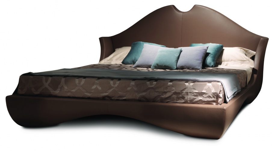 Double bed on a frame of wood with a high cushioned headboard ...