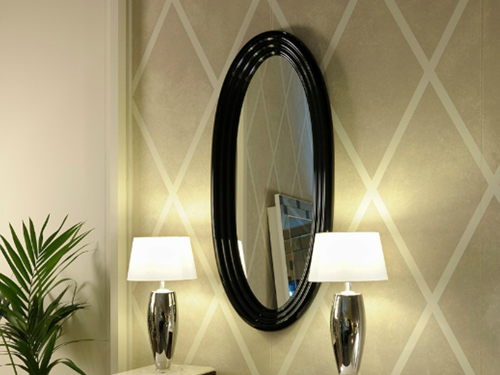 The oval mirror in finish from glossy black lacquer art for Wall and deco showroom milano
