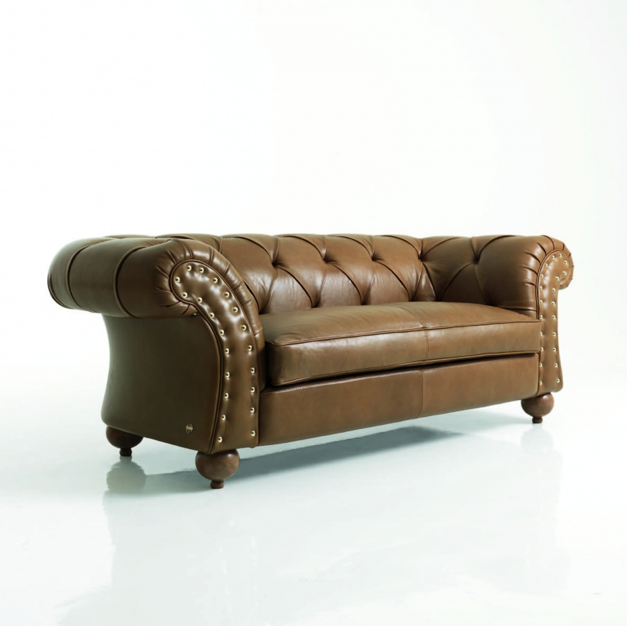 Two-seater sofa in leather with metal studs. David
