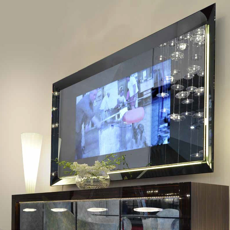 The Mirror Is Rectangular With A Container For The Tv